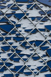 Pealing Paint Fence Abstract. A closeup of pealing paint on a sign attached to a chainlink fence Stock Photo