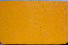 Pealing yellow paint Stock Images