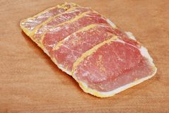 Peameal bacon on wood cutting board Royalty Free Stock Photo