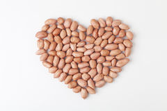 Peanut. Pile of peanuts on a white background Stock Photos