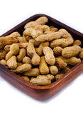 Peanut. In a wooden bowl isolated on a white background Stock Photos