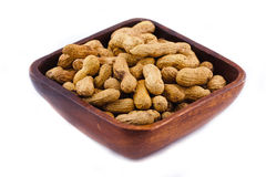 Peanut. In a wooden bowl isolated on a white background Royalty Free Stock Image