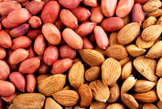 Peanut and almonds - a grocery background Royalty Free Stock Images