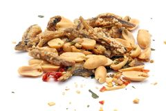 Peanut anchovy fry. With spice mix sesame on white background Stock Image