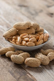Peanut or arachis in white bowl on wood table. Peanut or arachis in white bowl on wood table Stock Photos