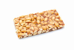 Peanut bar snack. A delicious peanut bar snack. Image isolated on white studio background Royalty Free Stock Images