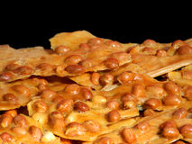 Peanut Brittle. Close view of peanut brittle against black background Royalty Free Stock Image