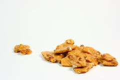 Peanut Brittle. Old fashioned peanut brittle on a white background Royalty Free Stock Photography