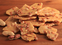 Peanut Brittle. Candy on a plate stock photography