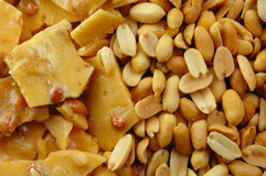 Peanut Brittle and Peanuts. Peanut brittle and nuts perfect as a background stock image