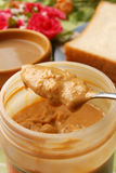 Peanut butter. On a knife Stock Images