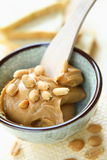 Peanut Butter. With whole nuts in glass bowl. There is excellent addition for sandwiches and desserts Royalty Free Stock Images