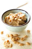 Peanut Butter. With whole nuts in glass bowl. There is excellent addition for sandwiches and desserts Royalty Free Stock Photos