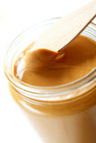 Peanut Butter. Open the peanuts butter jar. Peanut butter is excellent addition for sandwiches and desserts Royalty Free Stock Images