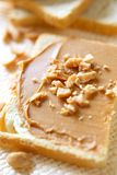 Peanut Butter. Slice of bread with peanut butter and nuts. Peanut butter is excellent addition for sandwiches and desserts Stock Photography
