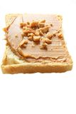 Peanut Butter. Slice of bread with peanut butter and nuts. Peanut butter is excellent addition for sandwiches and desserts Stock Images