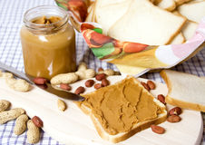 Peanut butter. Slice of bread with peanut butter spread Stock Photography