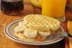 Peanut butter banana sandwich on a waffle Stock Images