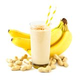 Peanut-butter banana smoothie with scattered ingredients over white Stock Images