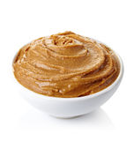 Peanut butter. Bowl of peanut butter isolated on white background Stock Photo