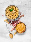 Peanut butter in the bowl. On a rustic background stock photos