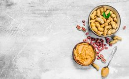 Peanut butter in the bowl. On a rustic background stock images