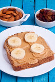 Peanut butter bread and banana Stock Images