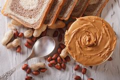 Peanut butter and bread close-up. horizontal top view Royalty Free Stock Photo