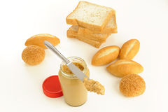 Peanut butter and bread on white Royalty Free Stock Photography