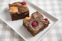 Peanut Butter Brownies with raspberries Stock Photos