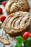 Peanut butter bun. Healthy sandwich made of wholegrain bread roll and peanut spread Royalty Free Stock Image