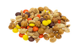 Peanut butter chips and candy trail mix on white background Stock Image