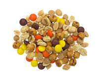 Peanut butter chips and candy trail mix on white background Royalty Free Stock Images