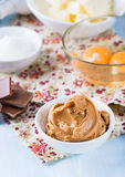 Peanut butter, chocolate chunks, eggs, sugar and cup of flour Stock Photo