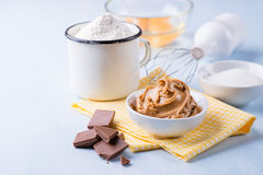 Peanut butter, chocolate chunks, eggs, sugar and cup of flour. Ingredients for baking. Selective focus Royalty Free Stock Photo
