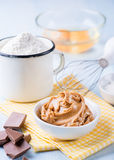 Peanut butter, chocolate chunks, eggs, sugar and cup of flour Royalty Free Stock Image