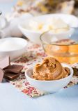 Peanut butter, chocolate chunks, eggs, sugar and cup of flour Stock Images