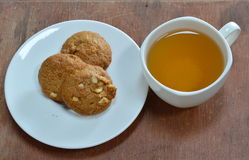 Peanut butter cookie and cup of tea. On table stock photography