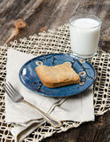 Peanut Butter Cookie and Milk Dessert. Peanut Butter Cookie Dessert with glass of milk in the background on a rustic farm table with a lace texture placemat royalty free stock photo