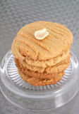 Peanut butter cookies. Stack of fresh made peanut butter cookies with a half peanut on top stock photo