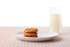 Peanut butter cookies on plate and glass of milk Stock Photos