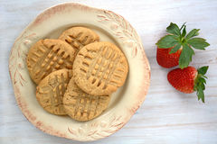 Peanut butter cookies on rustic white background. Fresh baked peanut butter cookies on rustic white background shot in natural light Stock Image