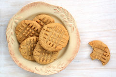 Peanut butter cookies on rustic white background. Fresh baked peanut butter cookies on rustic white background shot in natural light Royalty Free Stock Image