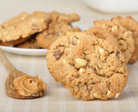 Peanut Butter Cookies. With a spoon of peanut butter royalty free stock image