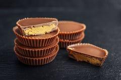 Peanut butter cups. Chocolate dessert on black background  closeup Stock Photo