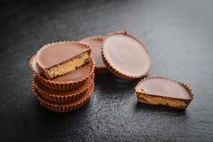 Peanut butter cups. Chocolate dessert on black background  closeup Stock Photos