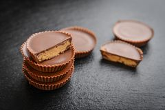 Peanut butter cups. Chocolate dessert on black background closeup stock photo