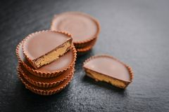 Peanut butter cups. Chocolate dessert on black background  closeup Royalty Free Stock Photography