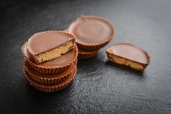 Peanut butter cups. Chocolate dessert on black background  closeup Royalty Free Stock Photo