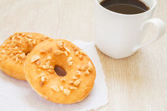 Peanut butter donut with coffee mug Royalty Free Stock Image